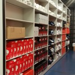 Athletic equipment storage - football team - New England Patriots equipment room - shoe storage