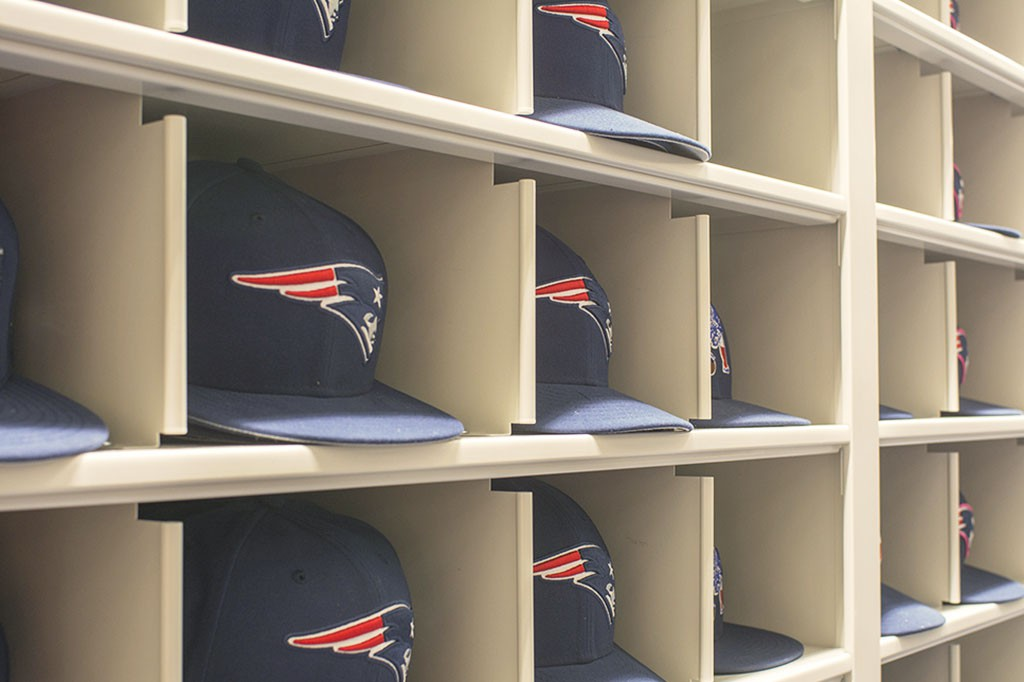 Sports team storage - New England Patriots equipment room - ballcaps